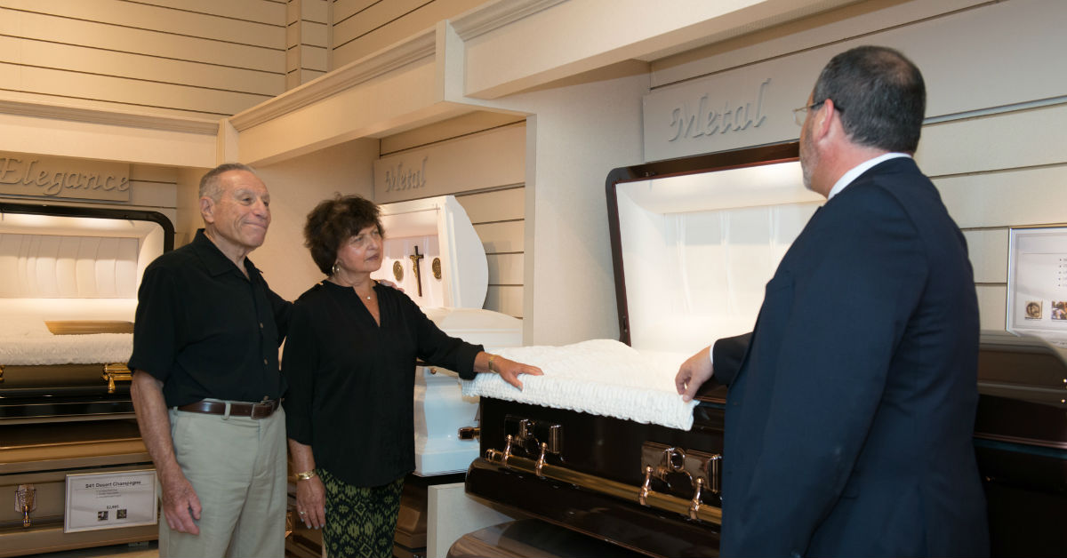 Funeral Director Garrett Jacobs shows some clients the different caskets available
