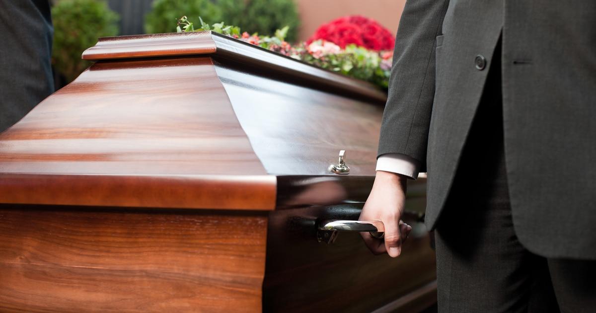 pallbearer holding casket