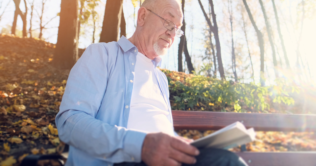 man reading book on grief
