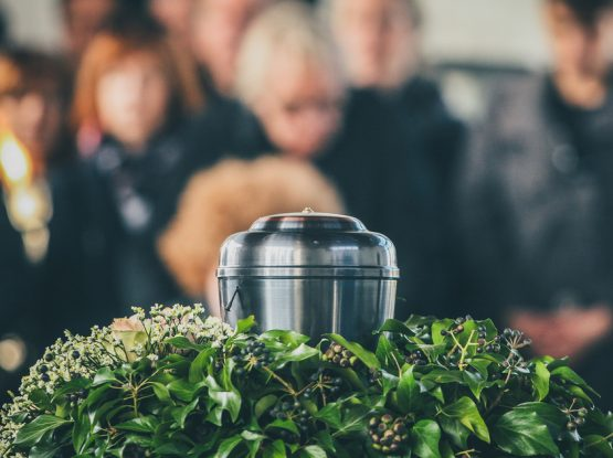 funeral attendees near urn